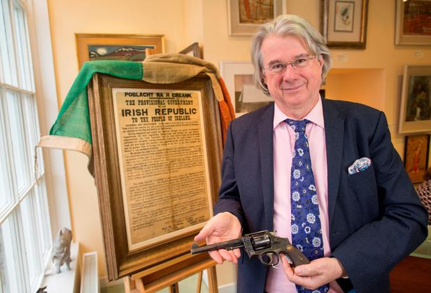 Ian Whyte with some of the items that will be on display including an original 1916 Proclamation and a Smith and Wesson revolver used by the Irish Volunteers. Photo: Fergal Phillips