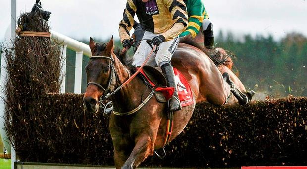Felix Yonger and Ruby Walsh, here jumping the last at Punchestown, can make a winning return to the rack in tomorrow's Tied Cottage Chase. Photo: Barry Cregg / Sportsfile