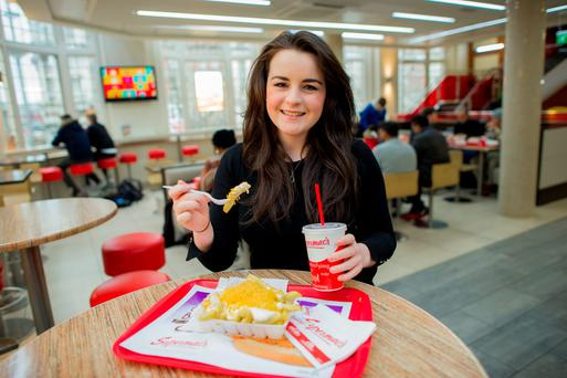 Elaine McCahill gets stuck into a Supermac's. Photo: Doug.ie