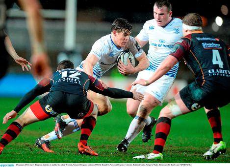 Garry Ringrose, Leinster, is tackled by Adam Warrenl, Newport Dragons