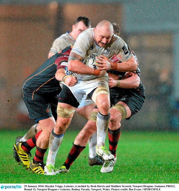 Hayden Triggs, Leinster, is tackled by Brok Harris and Matthew Screech, Newport Dragons