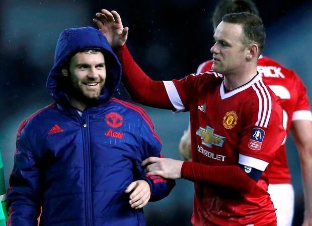 Manchester United's Juan Mata and Wayne Rooney celebrate at the end of the match