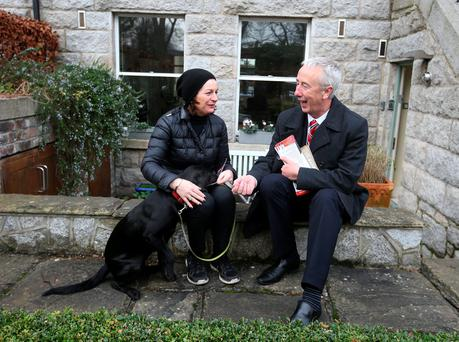 Labour's Kevin Humphreys speaks to Helen Nicholson, with her dog Harper, as he canvasses in Dartmouth Square in Dublin. Photo: Damien Eagers