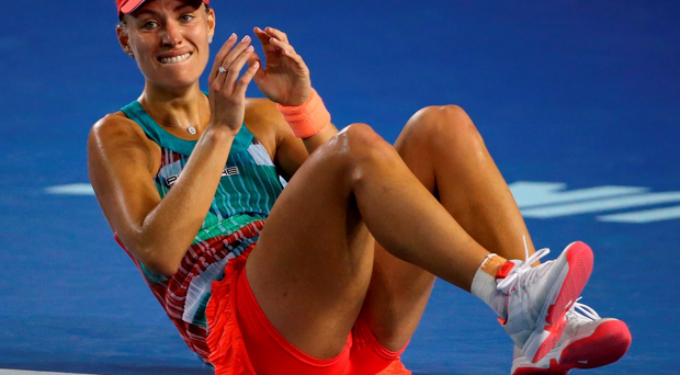 Angelique Kerber of Germany celebrates after defeating Serena Williams (AP Photo/Rick Rycroft)