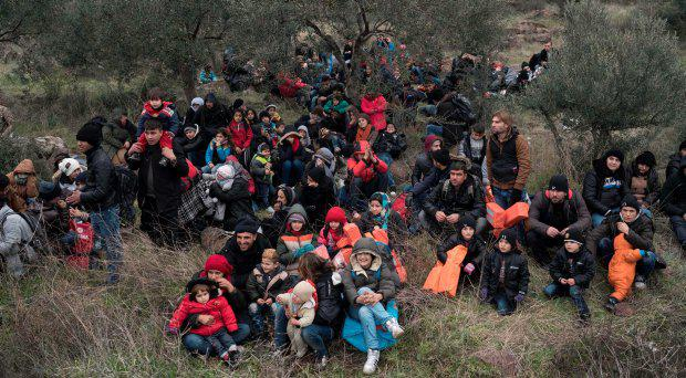 Migrants wait to travel to the Greek island of Lesbos, near the Aegean town of Ayvacik, Turkey, Friday, Jan. 29, 2016