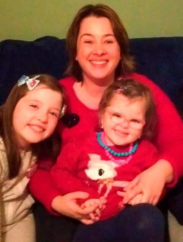 Caoimhe Burns with her mum and sister