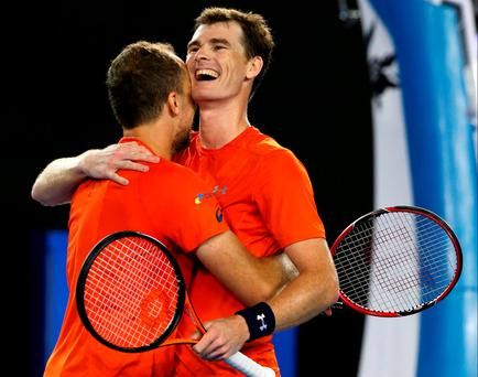 Jamie Murray, right, of Britain and Bruno Soares of Brazil celebrate after defeating Daniel Nestor of Canada and Radek Stepanek of the Czech Republic the men's doubles final at the Australian Open tennis championships in Melbourne
