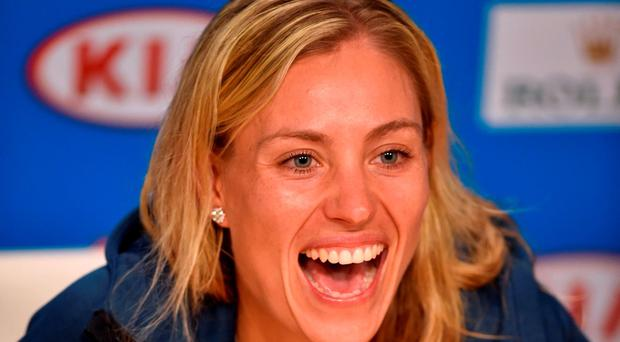 Angelique Kerber of Germany smiles during the post-victory press conference after her win over Serena Williams of the US in their women's singles final match on day 13 of the 2016 Australian Open tennis tournament in Melbourne