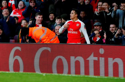 Arsenal's Alexis Sanchez is sent over the advertising boards by a challenge by Burnley's Joey Barton (not pictured) Action Images via Reuters / John Sibley