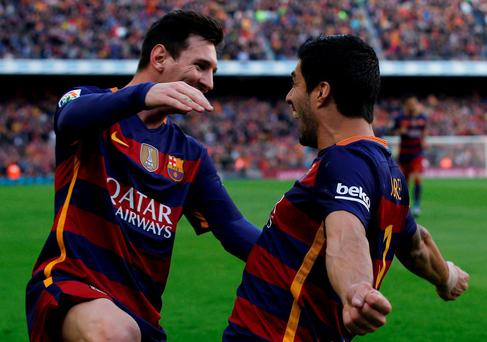 Barcelona's Luis Suarez celebrates with team mate Lionel Messi after scoring a goal. REUTERS/Albert Gea