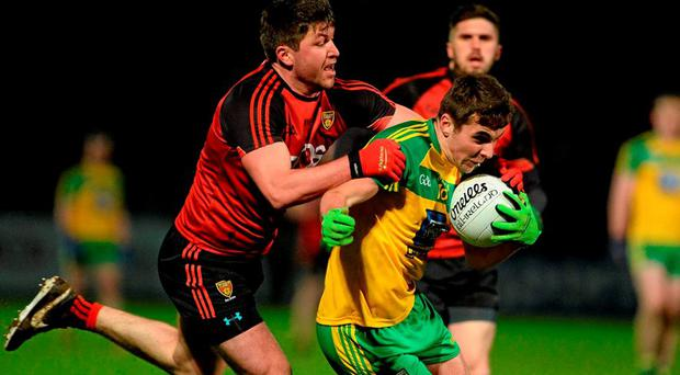 Michael Carroll, Donegal, in action against Peter Turley, Down. Allianz League, Division 1, Round 1, Down v Donegal, Páirc Esler, Newry, Co. Down. Picture credit: Oliver McVeigh / SPORTSFILE