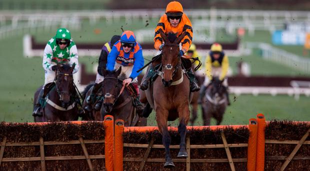 Thistlecrack and Tom Scudamore on their way to victory in the Cleeve Hurdle at Cheltenham yesterday