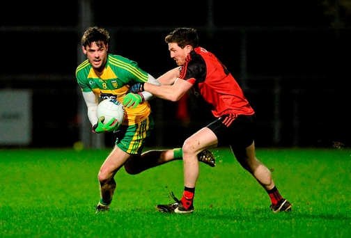 Odhran MacNaillais, Donegal, in action against Malachy Magee, Down in Newry last night Photo: Sportsfile