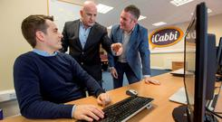 Sean Gallagher (centre) with iCabbi CEO and co-founder Gavan Walsh (right) and Brian Drysdale. Pic:Mark Condren