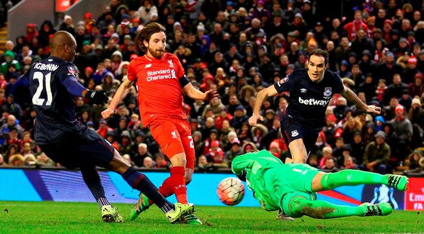 Liverpool's Joe Allen is foiled by Irish goalkeeper Darren Randolph of West Ham at Anfield last night. Photo by Clive Brunskill/Getty Images