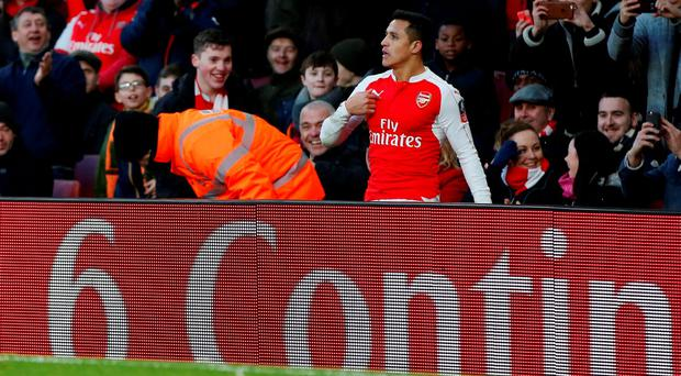 Arsenal's Alexis Sanchez is sent over the advertising boards by a challenge by Burnley's Joey Barton (not pictured). Action Images via Reuters / John Sibley