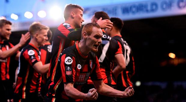 AFC Bournemouth's Shaun MacDonald celebrates after team mate Marc Pugh scores their side's second goal.