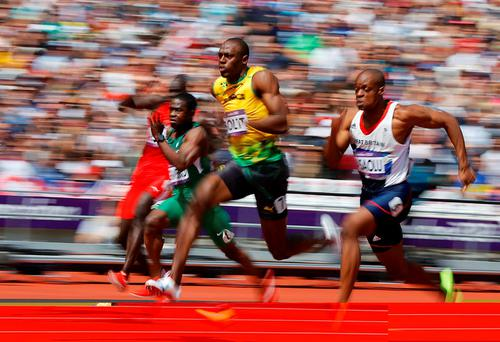 Sprinter Usain Bolt of Jamaica on his way to striking gold during the London 2012 Olympic Games. REUTERS/Phil Noble