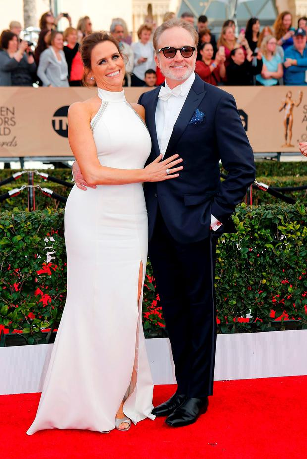 Actors Amy Landecker and Bradley Whitford arrive at the 22nd Screen Actors Guild Awards in Los Angeles, California January 30, 2016. REUTERS/Mike Blake