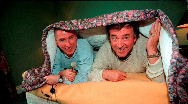 File photo dated 13/05/1993 of the BBC's Ken Bruce (left) and Sir Terry Wogan enjoying an extra hour in bed before presenting their radio programmes from Millstreet, Ireland, the venue for the Eurovision Song Contest, as veteran broadcaster Wogan has died aged 77 following a short illness