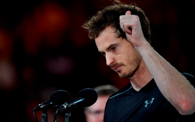 Britain's Andy Murray speaks before being presented with the runner's up trophy after he was defeated by Serbia's Novak Djokovic in the Australian Open. AFP PHOTO / PAUL CROCK .