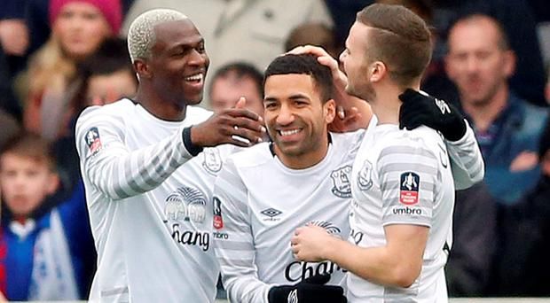 Arouna Kone celebrates scoring the first goal for Everton with Aaron Lennon and Tom Cleverley