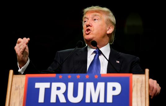 Republican presidential candidate Donald Trump speaks during a campaign rally at Clinton Middle School, Saturday, Jan. 30, 2016, in Clinton, Iowa. (AP Photo/Charlie Neibergall)