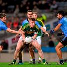 Dublin full-back Mick Fitzsimons (left) puts Kerry's Tommy Walsh under pressure Photo: Ray McManus / SPORTSFILE