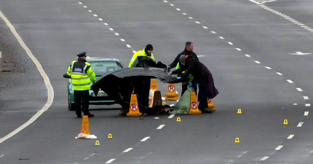Gardai at the scene of a road traffic collision on the Naas Road in which a man in his 20's was fatally injured when he was struck by a car. Photo: Laura Hutton/Collins Photo Agency.