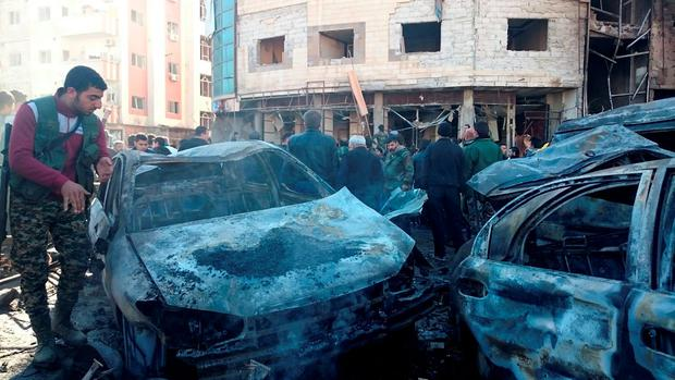 Residents and soldiers loyal to Syria's President Bashar al-Assad inspect damage after a suicide attack in Sayeda Zeinab, a district of southern Damascus, Syria January 31, 2016