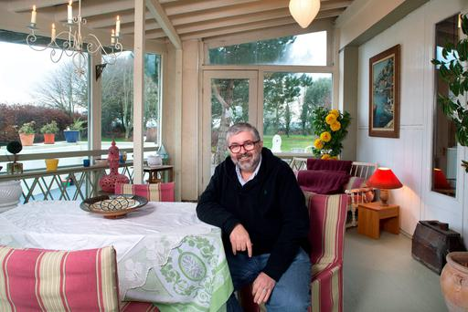 Tv and film producer and director Bill Hughes in his family home in Athy, Co. Kildare. Conservatory. Photo: Tony Gavin 20/1/2016
