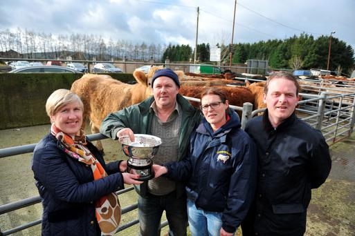 The overall champion bullock at the 35th annual fatstock Show & Sale Day1 Sat 30th January Carnew Mart. Pictureed L/R: Jennifer King presenting the cup, sponsored by Enser O'Connor Solicitors to the winning owner Ken Tyner, Dawn Tully from Carnew Mart and Allen Mooney sponsor. Photo: Roger Jones.