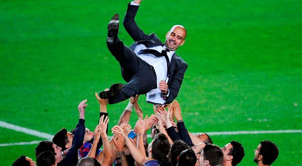 Barcelona players throw Pep Guardiola in the air after his final game in charge in 2012. Photo: Getty