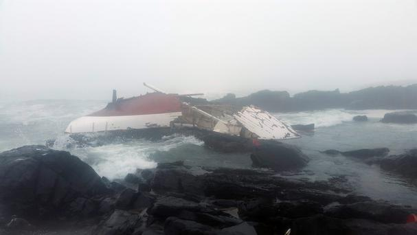Wreckage of the yacht which ran aground on rocks off the coast of South Africa, claiming the life of a 49-year-old Irish woman. Photo: National Sea Rescue Institute