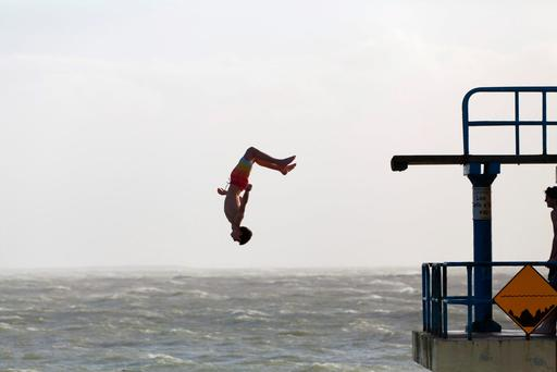 Storm Henry – the eighth since November – greeted the opening day of spring with winds of up to 130kmh. It will be followed by Storm Imogen. However, the high seas didn't stop teenagers jumping off the diving platform at Blackrock in Salthill, Co Galway. Photo: Andy Newman