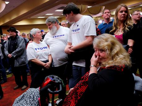 Supporters of Republican presidential candidate Donald Trump react as they gather for a post-caucus rally in Des Moines, Iowa February 1, 2016. REUTERS/Carlos Barria TPX IMAGES OF THE DAY