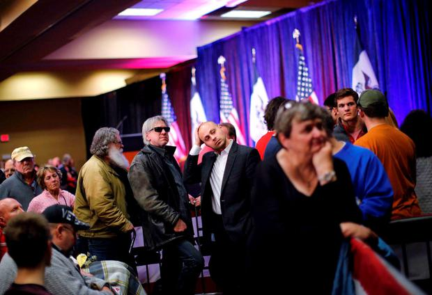 Supporters of Republican presidential candidate Donald Trump watch results as they gather for a post-caucus rally in Des Moines, Iowa February 1, 2016. REUTERS/Carlos Barria