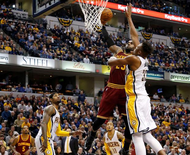 Cleveland Cavaliers forward LeBron James (23) shoots the ball in front of Indiana Pacers center Myles Turner (33) at Bankers Life Fieldhouse. The Cavaliers won 111-106 in overtime. Mandatory Credit: Brian Spurlock-USA TODAY Sports