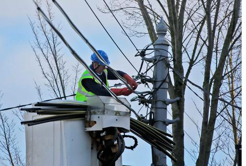 A workman repairs power lines in Lucan village after a night of high winds from Storm Henry. Photo: Colin Keegan
