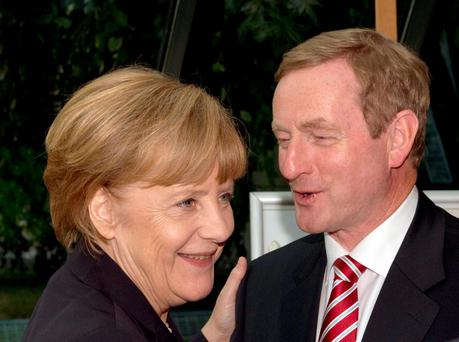 "Taoiseach Enda Kenny greeted by German Chancellor Angela Merkel at a summit in Berlin: ""The EU wants Apple to pay the Irish exchequer more money, and Ireland is actively arguing against this..."""