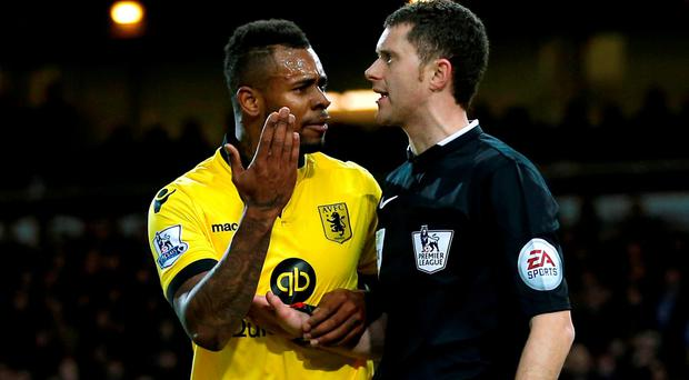 Aston Villa's Jordan Ayew remonstrates with the assistant referee after being sent off Action Images via Reuters / Andrew Couldridge