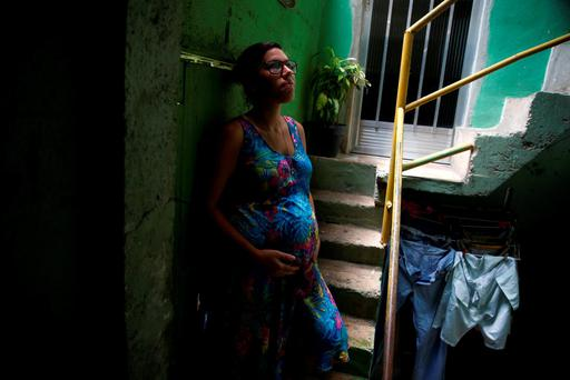 Kaitie Resende, who is seven months' pregnant, outside her home in the Vila Canoas slum in Rio de Janeiro, Brazil, yesterday. REUTERS/Pilar Olivares