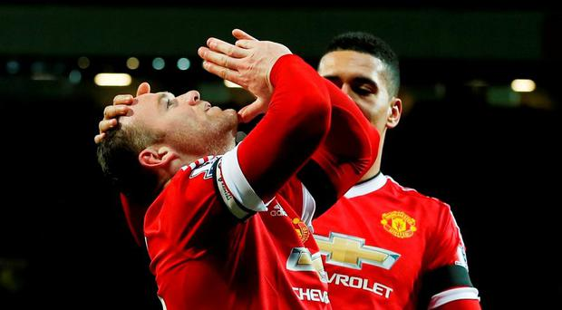 Wayne Rooney celebrates scoring the third goal for Manchester United Reuters / Phil Noble