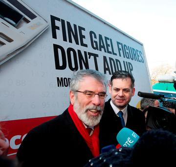 Sinn Fein's Gerry Adams and Pearse Doherty at the launch of a billboard which says Fine Gael's numbers do not add up. Photo: Tom Burke