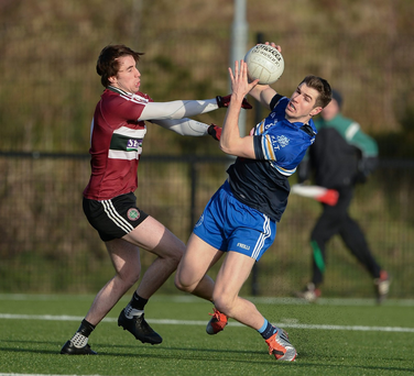 Emmett O'Connaighle, Dublin Institute of Technology in action against Conall McCann,St Mary's University College Belfast (SPORTSFILE)
