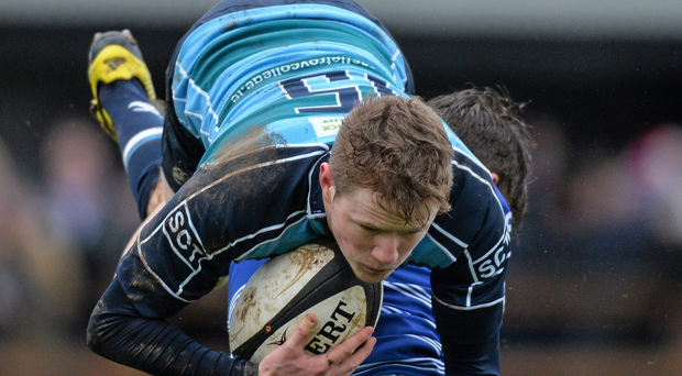 Joseph Conway, Castletroy College, is tackled by James Flanagan, St. Clements College (SPORTSFILE)