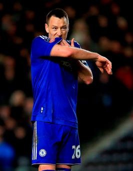 John Terry is playing 'perfectly', according to Guus Hiddink (PA)