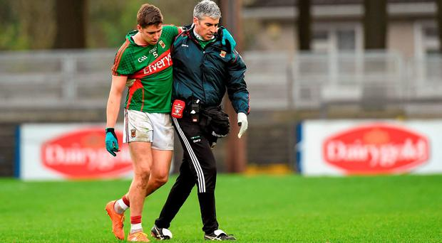 Lee Keegan is assisted off the pitch by Dr Sean Moffatt after picking up an injury. Picture credit: Diarmuid Greene / SPORTSFILE