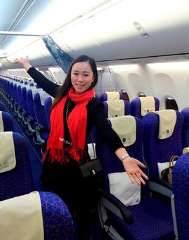 A Chinese woman surnamed Zhang posing for photos on an empty flight from Wuhan to Guangzhou, after the China Southern flight was delayed for 10 hours. Photo: AFP/Getty Images