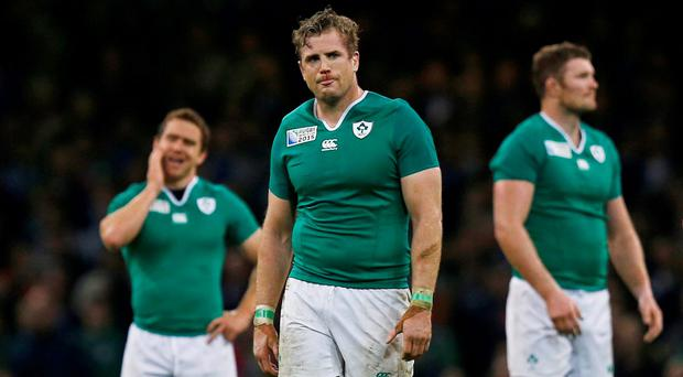 Jamie Heaslip and team mates look dejected after the defeat to Argentina in the quarter-final of the Rugby World Cup
